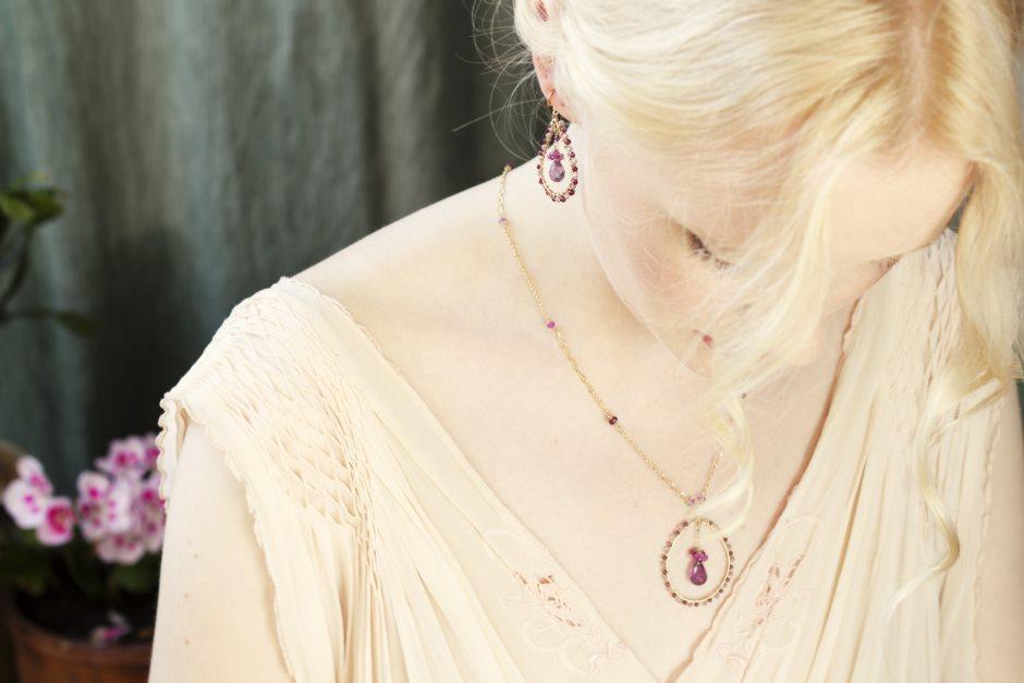 Model wears amethyst earrings and necklace